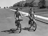1950s Teen Boy Girl Couple Riding Bikes Down Residential Street Photographic Print