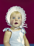1960s Blonde Baby Blue Eyes Wearing Ruffled Bonnet Facial Expression of Wonder Photographic Print