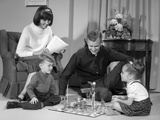 1960s Family Children Playing Game in Living Room Mousetrap Photographie