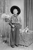 Ten-Year-Old Boy Poses in a Cowboy Outfit, Ca. 1951 Photographic Print