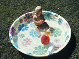 1970s Baby Sitting in Plastic Backyard Kiddy Pool Viewed from Above Photographic Print