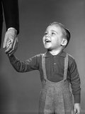 1960s Boy Holding Adult Male Hand Smiling Photographic Print