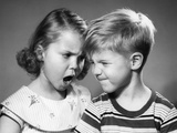 1950s Boy and Girl Arguing Head to Head Photographic Print