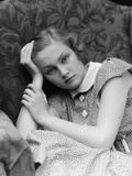 1930s Woman Moping Looking Sad or Depressed or with a Headache Leaning Her Head on Her Hand Photographic Print