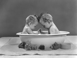 1950s Twin Babies Sitting Head to Head in Metal Bath Tub Photographic Print