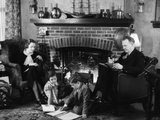 1930s Family of Four Sitting in Front Fireplace Photographic Print