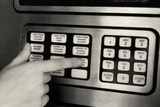 1980s Hand Pressing Buttons on Panel of Vintage Automatic Teller Machine ATM Photographic Print