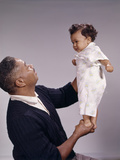 1960s African American Grandfather Playing Lifting Up with Grandson Photographic Print