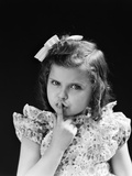 1950s Child Serious Little Girl Pressing Finger to Lips Hush Be Quiet Secret Photographic Print