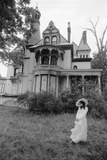 1970s Woman in Victorian Costume Standing on Front Lawn of Large Abandoned Haunted Victorian Home Photographic Print