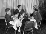 1960s Smiling Happy Family of Four Eating Meal in Restaurant Photographic Print