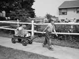 1950s Boy Pulling Groceries in Wagon Photographic Print