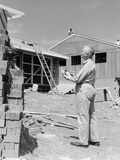 1950s Senior Man with Clipboard on Construction Site Photographic Print