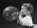 1940s Boy Blowing Up Balloon Photographic Print