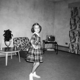 Young Girl Dances around the Living Room, Ca. 1963 Photographic Print