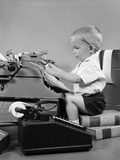 1950s Child Typing Sitting at Typewriter Photographic Print