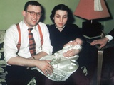 Young Couple Holding Baby Boy in Christening Gown, Ca. 1952 Photographic Print