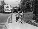 1950s Children Skipping Walking on Sidewalk Watch Children Sign Photographic Print