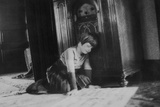Young Girl Listens to the Radio While Reading Paper, Ca. 1930 Photographic Print