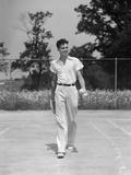 1930s Man Walking across Tennis Court Holding Tennis Racket and Balls Photographic Print