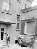 Mother with Her Two Sons in the Courtyard of their German Home, Ca. 1946 Photographic Print