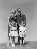 1950s-1960s Portrait Family Standing in Grass Mother Father Daughter Son Photographic Print