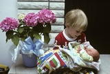 1970s Boy Holding a Newborn Baby Photographic Print