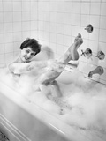 1950s Sexy Smiling Woman Taking a Soap Suds Bubble Bath in Tub Photographic Print
