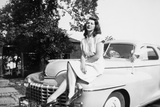 An Eighteen Year Old Woman Poses on the Hood Her Car, Ca. 1947 Photographic Print