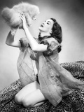 1950s Young Woman Wearing Sexy Lingerie Kneeling on Leopard Skin Holding Fluffy Dog Photographic Print