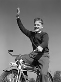 1940s-1950s Smiling Boy Riding Bike Waving Arm in Air Photographic Print