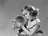 1950s-1960s Guess Who Girl Holds Her Hands over Boys Eyes Blind Game Teasing Playing Boy Girls Photographic Print