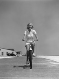 1940s Summer Time Smiling Blonde Woman Riding Bike on Seashore Beach Boardwalk Directly Photographic Print