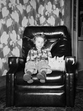 Young Girl Sits with Her Two Cats in a Leather Chair, Ca. 1960 Photographic Print
