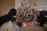 Children Peeking around Corner at Christmas Tree Photographic Print by William Gottlieb