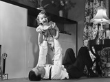 1950s Father Lying Floor Holding Daughter Girl Up in the Air Photographic Print