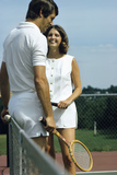 1970s Smiling Couple Standing by Net on Tennis Court Holding Wood Rackets Fotografiskt tryck