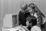 1980s Boys and Girl Playing Games on a Computer Reproduction photographique