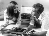 1960s Teen Couple Playing Lp Vinyl Records on Portable Phonograph Photographic Print