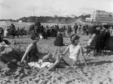 1920s Two Women Sitting on the Beach in Bathing Suits Photographic Print