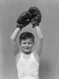 1940s Boy Child Winner Wearing Boxing Gloves Holding Hands Above Head Photographic Print