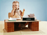 1960s Baby Businessman Diaper Sitting at Loan Desk Wearing Eyeglasses Talking on Telephone Photographic Print