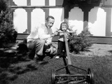 A Father Show His Two Year Old Daughter How to Mow the Lawn, Ca. 1956 Photographic Print