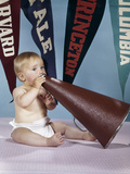 1960s Baby Shouting into Cheerleader Megaphone College Pennants in Background Photographie