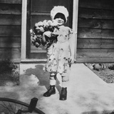Young Girl with a Bouquet of Flowers on Her Doorstep, Ca. 1928 Photographic Print