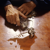 1980s Hand Holding Spilled Alcoholic Drink on Bar with Keys in Other Hand Photographic Print