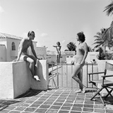 1930s Man Woman Wearing Bathing Suits on Terrace Overlooking Swimming Pool Woman on Diving Board Reproduction photographique