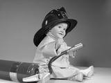 1960s Baby Fireman with Safety Hat Coat and Fire Extinguisher Photographic Print