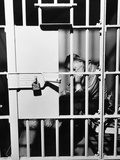 1960s Man Seated on Bench in Jail Cell with Head in Hand Looking Downward Photographic Print
