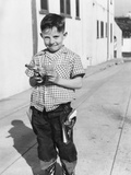 Young Boy Plays Cowboy in a California Alley, Ca. 1952 Photographic Print